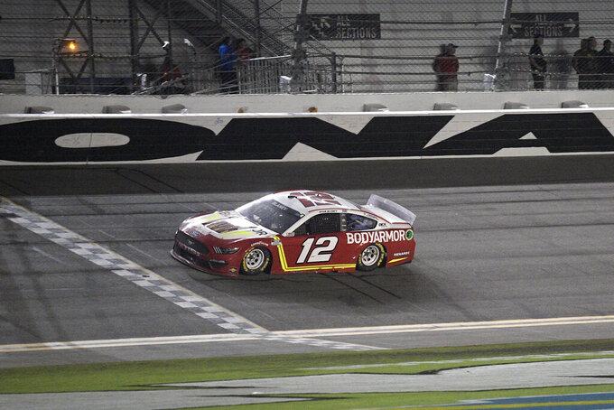 Ryan Blaney (12) approaches the finish line to win a NASCAR Cup Series auto race at Daytona International Speedway, Saturday, Aug. 28, 2021, in Daytona Beach, Fla. (AP Photo/Phelan M. Ebenhack)