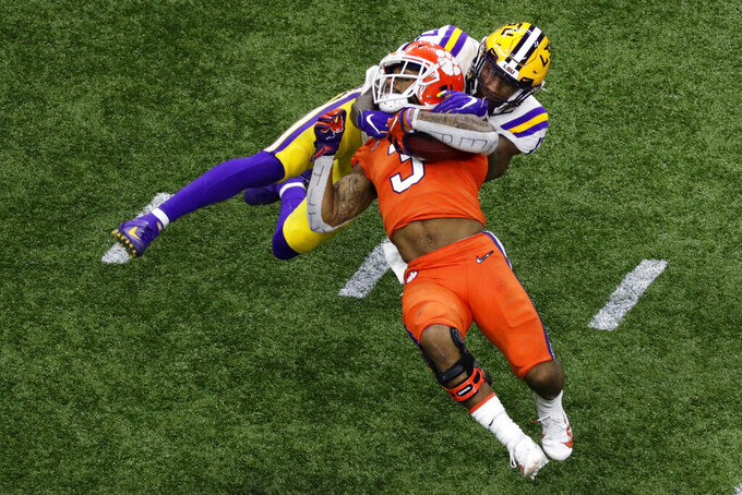 Clemson wide receiver Amari Rodgers is tackled by LSU's Racey McMath during the second half of a NCAA College Football Playoff national championship game Monday, Jan. 13, 2020, in New Orleans. (AP Photo/Eric Gay)