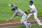 Houston Astros' Myles Straw (3) is tagged out in a rundown by Texas Rangers' Isiah Kiner-Falefa, right, as he tried to advance home on a fielder's choice hit by Alex Bregman in the third inning of a baseball game in Arlington, Texas, Saturday, Sept. 26, 2020. (AP Photo/Tony Gutierrez)