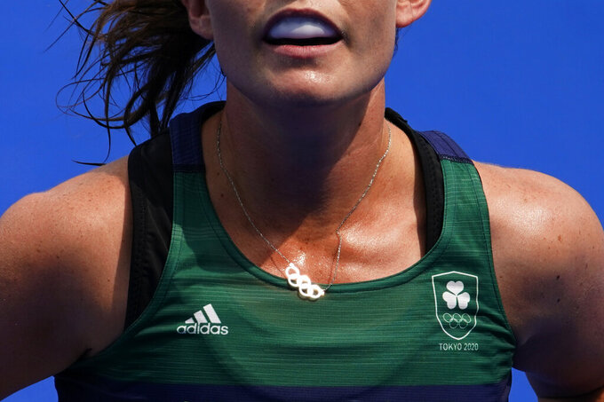 Ireland midfield Lizzy Holden (14) wears a necklace with the Olympic rings during a women's field hockey match against India at the 2020 Summer Olympics, Friday, July 30, 2021, in Tokyo, Japan. (AP Photo/John Locher)