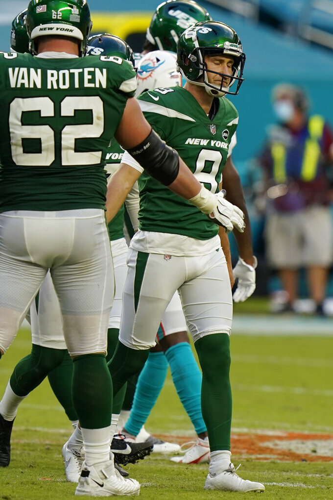 New York Jets kicker Sam Ficken (9) reacts after missing a field goal during the second half of an NFL football game against the Miami Dolphins, Sunday, Oct. 18, 2020, in Miami Gardens, Fla. (AP Photo/Lynne Sladky)