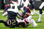 New England Patriots quarterback Cam Newton (1) is sacked by Houston Texans strong safety Justin Reid (20) during the second half of an NFL football game, Sunday, Nov. 22, 2020, in Houston. (AP Photo/David J. Phillip)