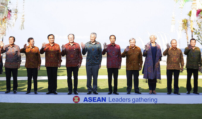 Southeast Asian leaders pose for family photo during ASEAN Leaders Gathering ont the sidelines of International Monetary Fund and World Bank Annual Meeting 2018 in Nusa Dua, Bali, Indonesia, Thursday, Oct. 11, 2018. From left, Cambodia's Prime Minister Hun Sen, Brunei Sultan Hassanal Bolkiah, Thailand's Prime Minister Prayuth Chan-ocha, World Bank President Jim Yong Kim, Singapore Prime Minister Lee Hsien Loong, Indonesia's President Joko Widodo, United Nations Secretary General Antonio Guterres, IMF Managing Director Christine Lagarde, Vietnam's Prime Minister Nguyen Xuan Phuc and  Philippines President Rodrigo Duterte. (Johannes P. Christo/Pool Photo via AP)