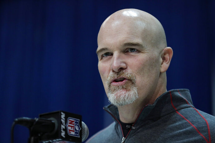 FILE - In this Feb. 25, 2020, file photo, Atlanta Falcons head coach Dan Quinn speaks during a press conference at the NFL football scouting combine in Indianapolis. The Dallas Cowboys agreed to terms Monday, Jan. 11, 2021, with former Atlanta coach Quinn as defensive coordinator, turning over a unit that was among the worst in franchise history to someone who built his reputation on defense in Seattle. (AP Photo/Michael Conroy, File)