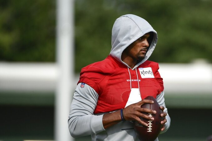 Texans quarterback Deshaun Watson (4) practices with the team during NFL football practice Thursday, July 29, 2021, in Houston. (AP Photo/Justin Rex)