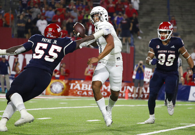 Fresno State defensive tackle Leonard Payne Jr., left, and defensive end David Perales, right, get to UNLV quarterback Cameron Friel during the second half of an NCAA college football game in Fresno, Calif., Friday, Sept. 24, 2021. (AP Photo/Gary Kazanjian)