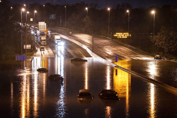 Cars are seen submerged on I-24 near Antioch Pike in Nashville, Tenn., Sunday, March 28, 2021. Heavy rain across Tennessee flooded homes and roads early Sunday, prompting officials to rescue numerous people from houses, apartments and vehicles as a line of severe storms crossed the state. (Andrew Nelles/The Tennessean via AP)