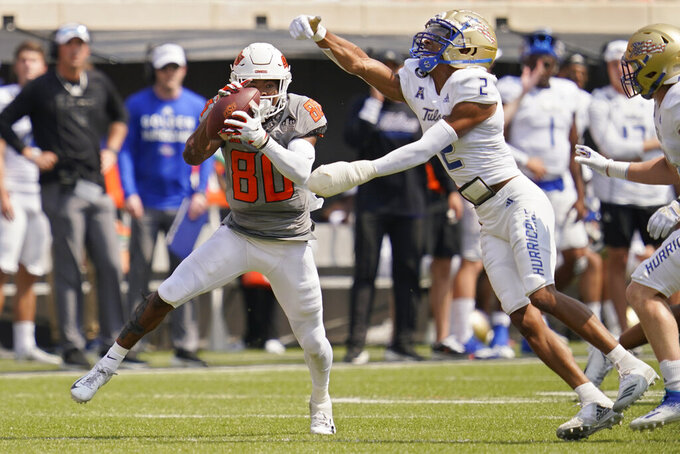 Oklahoma State wide receiver Brennan Presley (80) catches a pass in front of Tulsa cornerback Travon Fuller (2) in the first half of an NCAA college football game, Saturday, Sept. 11, 2021, in Stillwater, Okla. (AP Photo/Sue Ogrocki)