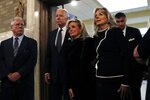 Congresswoman Debbie Dingell, center, is escorted by former Vice President Joe Biden, up the aisle at the Church of the Divine Child, for the funeral for her husband John Dingell, Tuesday, Feb. 12, 2019, in Dearborn, Mich. Dingell, the longest-serving member of Congress in American history, was first elected in 1955 and retired in 2014. The Democrat was 92. (AP Photo/Carlos Osorio)