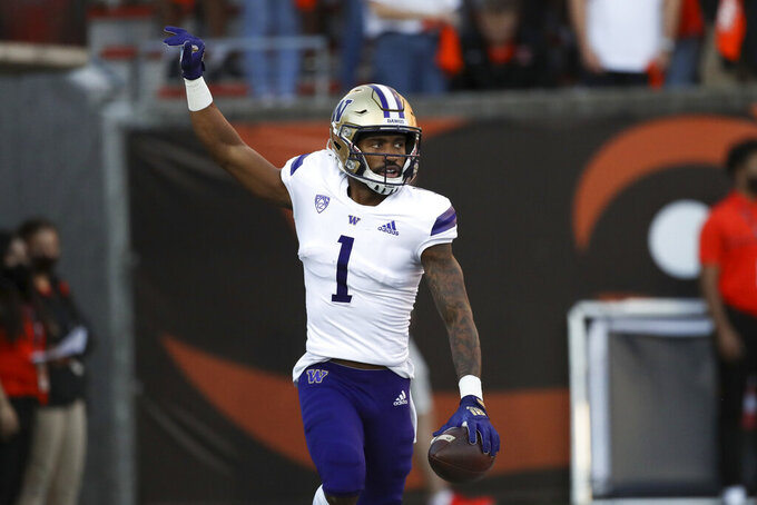 Washington wide receiver Terrell Bynum (1) celebrates after scoring a touchdown during the first half of an NCAA college football game against Oregon State on Saturday, Oct. 2, 2021, in Corvallis, Ore. (AP Photo/Amanda Loman)