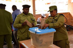 Tanzanian army personal vote during early voting in Zanzibar during Tanzania election Tuesday, Oct. 27, 2020. A major opposition party in Tanzania is accusing police of shooting dead at least nine citizens amid unrest over alleged fraud on the eve of the country's presidential election.(AP Photo)