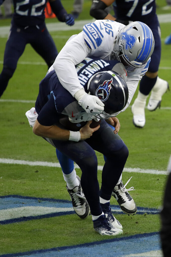 Detroit Lions defensive end Romeo Okwara sacks Tennessee Titans quarterback Ryan Tannehill for a safety during the first half of an NFL football game Sunday, Dec. 20, 2020, in Nashville, Tenn. (AP Photo/Ben Margot)