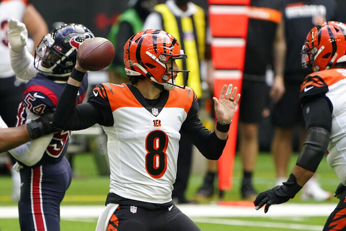 Cincinnati Bengals quarterback Brandon Allen (8) throws a pass against the Houston Texans during the first half of an NFL football game Sunday, Dec. 27, 2020, in Houston. (AP Photo/Eric Christian Smith)