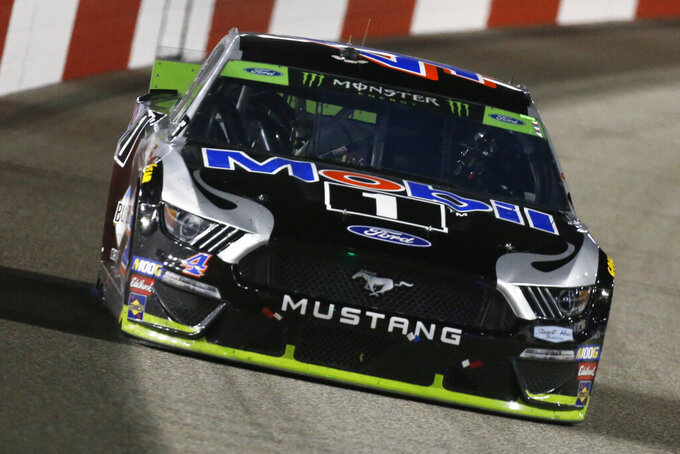 Kevin Harvick (4) drives into turn one during the NASCAR Monster Energy Cup series auto race at Richmond Raceway in Richmond, Va., Saturday, Sept. 21, 2019. (AP Photo/Steve Helber)