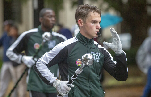 Justin Heideman leads the Jeff Davis High School Marching Band in the annual Magic City Classic parade in downtown Birmingham, Ala., on Saturday Oct. 26, 2019. (Kirsten Fiscus/The Montgomery Advertiser via AP)
