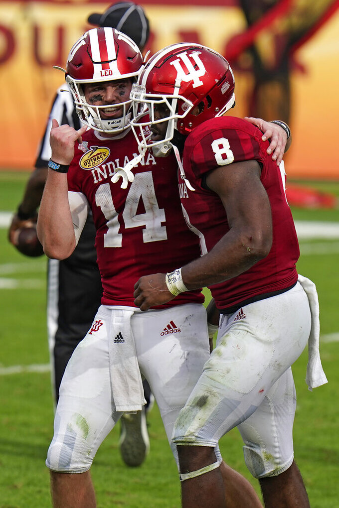 Indiana running back Stevie Scott III (8) celebrates with quarterback Jack Tuttle after scoring against Mississippi during the second half of the Outback Bowl NCAA college football game Saturday, Jan. 2, 2021, in Tampa, Fla. (AP Photo/Chris O'Meara)