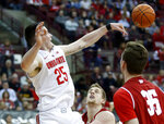 Ohio State forward Kyle Young, left, blocks a by Wisconsin guard Brevin Pritzl, center, and forward Nate Reuvers during the first half of an NCAA college basketball game in Columbus, Ohio, Sunday, March 10, 2019. (AP Photo/Paul Vernon)