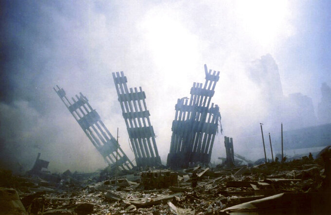 ADVANCE FOR PUBLICATION ON SUNDAY, SEPT. 5, AND THEREAFTER - FILE - In this Tuesday, Sept. 11, 2001 file photo, the remains of the World Trade Center stand amid other debris following the terrorist attack on the buildings in New York. (AP Photo/Alexandre Fuchs, File)