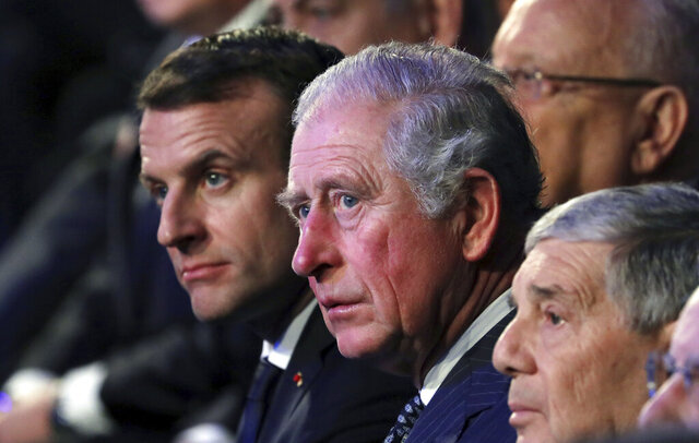 FILE- In this Thursday, Jan 23, 2020 file photo, from left, French President Emmanuel Macron and Britain's Prince Charles attend the World Holocaust Forum at the Yad Vashem Holocaust memorial museum in Jerusalem.  Britain's Prince Charles will host French President Emmanuel Macron for a special celebration marking the 80th anniversary of Gen. Charles De Gaulle's defiant appeal to the French people to resist the Nazis during World War II. Charles and his wife, the Duchess of Cornwall, will receive Macron at his Clarence House home with a Guard of Honor formed  by Number 7 Company of the Coldstream Guards and accompanied the Band of the Coldstream Guards on Thursday, June 18, 2020. (Abir Sultan/Pool Photo via AP, File)