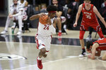 Washington State guard Noah Williams gets control of the ball after a scramble for a rebound following his missed shot during the second half of the team's NCAA college basketball game against Utah in Pullman, Wash., Thursday, Jan. 21, 2021. (AP Photo/Young Kwak)