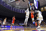 Florida guard KeVaughn Allen (5) shoots over LSU forward Kavell Bigby-Williams (11) in overtime of an NCAA college basketball game Wednesday, Feb. 20, 2019, in Baton Rouge, La. Florida won 82-77. (AP Photo/Bill Feig)