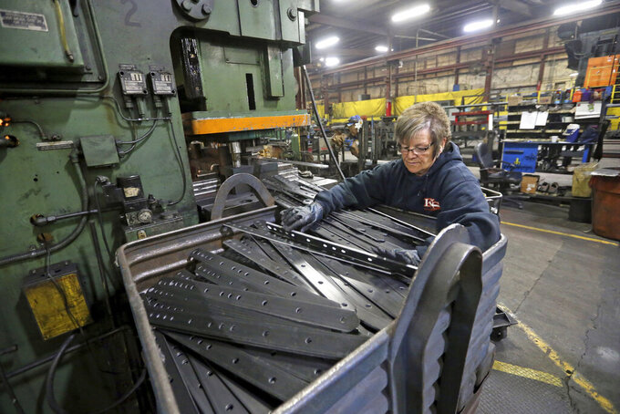 FILE - In this Thursday, April 22, 2021 file photo, Marie Tibbott sorts product at EIP Manufacturing in Earlville, Iowa. Growth in U.S. manufacturing picked up in May, even as supply chain problems persist and businesses continue to struggle to find workers. The Institute for Supply Management, a trade group of purchasing managers, said Tuesday, June 1 that its index of manufacturing activity rose in May to a reading of 61.2 from 60.7 in April. (Jessica Reilly/Telegraph Herald via AP, File)