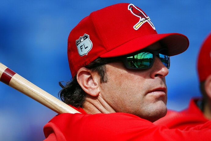 FILE - In this March 17, 2017, file photo, St. Louis Cardinals manager Mike Matheny (22) watches batting practice before a spring training baseball game against the New York Mets in Port St. Lucie, Fla. The Kansas City Royals have hired Matheny as manager on Thursday, Oct. 31, 2019. The 49-year-old Matheny was manager of the cross-state Cardinals from 2012-18, going 591-474 and becoming the first manager to reach the postseason his first four seasons.  (AP Photo/John Bazemore, File)