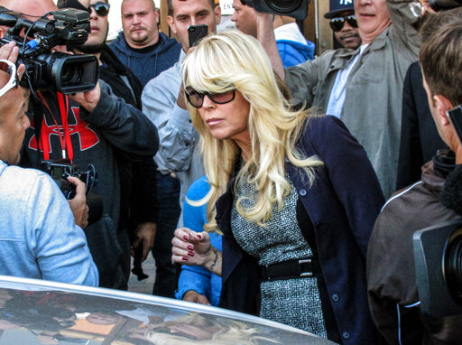 FILE - In this Sept. 24, 2013 file photo, Dina Lohan leaves court in Hempstead, N.Y., after pleading not guilty to drunken driving charges. Lohan pleaded guilty to drunken driving on Tuesday, Sept. 28, 2021, and is expected to be sentenced to 18 days in jail and five years' probation for rear-ending another car on Long Island and leaving the scene. (AP Photo/Frank Eltman, File)