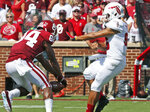 Oklahoma wide receiver Lee Morris (84) blocks a punt by Florida Atlantic punter Sebastian Riella (96) in the first half of an NCAA college football game in Norman, Okla., Saturday, Sept. 1, 2018. Oklahoma's Curtis Brown recovered the ball in the end zone for a touchdown. (AP Photo/Sue Ogrocki)