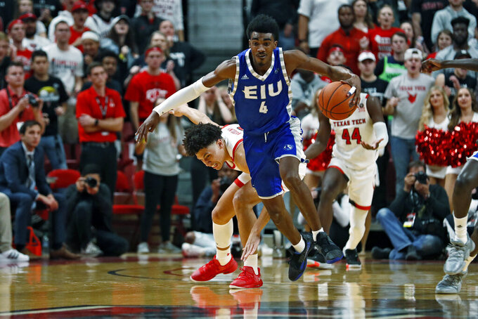 Eastern Illinois' Marvin Johnson (4) steals the ball from Texas Tech's Clarence Nadolny (2) during the first half of an NCAA college basketball game Tuesday, Nov. 5, 2019, in Lubbock, Texas. (AP Photo/Brad Tollefson)