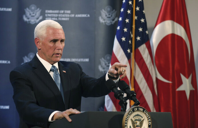 U.S. Vice President Mike Pence speaks at the U.S. ambassador's residence during a news conference in Ankara, Turkey, Thursday, Oct. 17, 2019. Pence announced that the U.S. and Turkey had agreed to a five-day cease-fire in northern Syria to allow for a Kurdish withdrawal from a security zone roughly 20 miles south of the Turkish border, in what appeared to be a significant embrace of Turkey's position in the week-long conflict. (AP Photo/Burhan Ozbilici)
