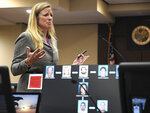 With a chart showing the connection of the defendants to the Adelson family and Dan Markel in the foreground, Assistant State Attorney Georgia Cappleman presents her closing argument in the trial for Markel's 2014 murder, in Tallahassee, Fla., on Thursday, Oct. 10, 2019. (Alicia Devine/Tallahassee Democrat via AP)