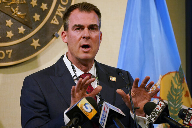 FILE - In this Monday, Nov. 16, 2020, file photo, Oklahoma Gov. Kevin Stitt speaks during a news conference in Oklahoma City. A much-anticipated Medicaid expansion is coming to Oklahoma in 2021 after years of resistance from Republicans in the Legislature and the governor's office. (AP Photo/Sue Ogrocki, File)
