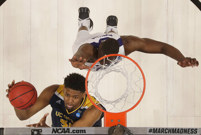 UC Irvine forward Elston Jones, bottom, shoots against Kansas State forward Makol Mawien during the first half of a first round men's college basketball game in the NCAA Tournament Friday, March 22, 2019, in San Jose, Calif. (AP Photo/Ben Margot)