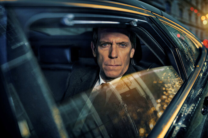 """This image released by PBS shows Hugh Laurie as a heedless British politician beset by scandal in the four-episode series """"Roadkill,"""" premiering on MASTERPIECE, Sunday, Nov. 1, 2020 on PBS.  (MASTERPIECE/PBS via AP)"""