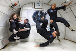 In this July 11, 2021 photo provided by John Kraus, from left, Hayley Arceneaux, Chris Sembroski, Jared Isaacman and Sian Proctor float during a zero gravity flight out of Las Vegas. The plane, a modified Boeing 727, flies multiple parabolic arcs to provide 20-30 seconds of weightlessness. (John Kraus/Inspiration4 via AP)