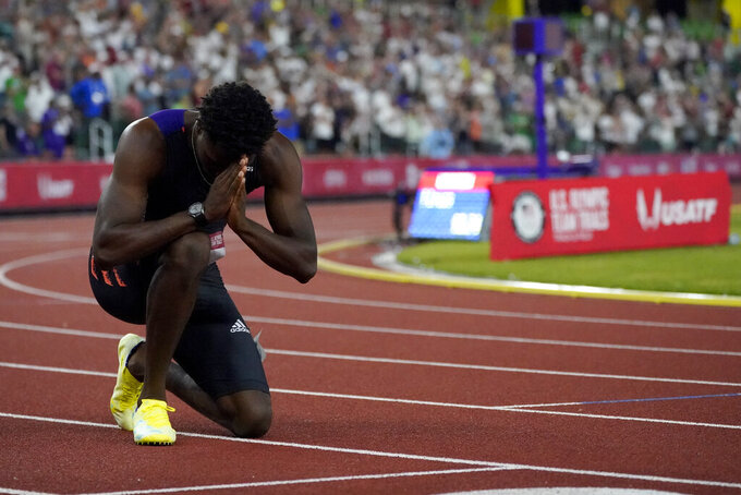 Noah Lyles reacts after winning the final in the men's 200-meter run at the U.S. Olympic Track and Field Trials Sunday, June 27, 2021, in Eugene, Ore. (AP Photo/Charlie Riedel)
