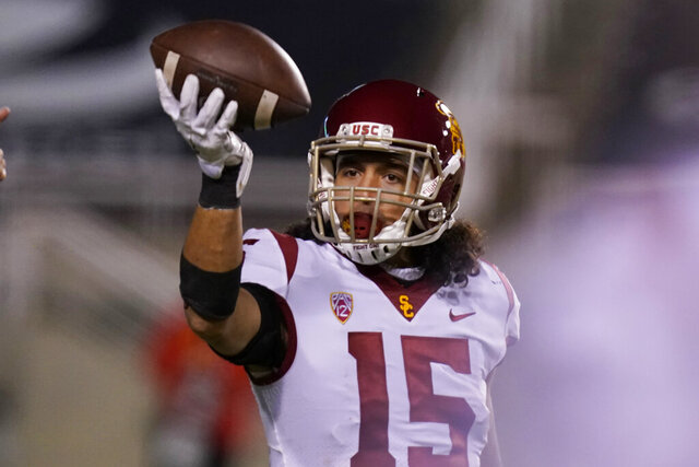 Southern California safety Talanoa Hufanga (15) celebrates after his interception against Utah in the second half of an NCAA college football game Saturday, Nov. 21, 2020, in Salt Lake City. Hufanga was selected to The Associated Press All-America first-team defense, Monday, Dec. 28, 2020. (AP Photo/Rick Bowmer)
