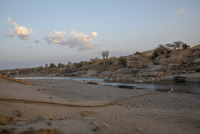 The banks of the Tekeze River, on the Sudan-Ethiopia border after Ethiopian forces blocked people from crossing into Sudan, in Hamdayet, eastern Sudan, March 16, 2021. Ethiopia is at right, and Sudan is on the left. (AP Photo/Nariman El-Mofty)