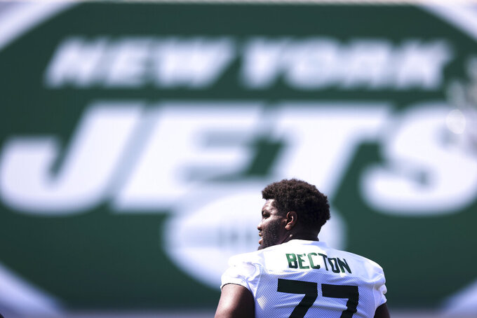 New York Jets offensive tackle Mekhi Becton (77) looks on during practice at the team's NFL football training facility, Saturday, July. 31, 2021, in Florham Park, N.J. (AP Photo/Rich Schultz)