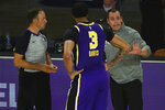 Los Angeles Lakers coach Frank Vogel talks with forward Anthony Davis (3) during the second quarter of the team's NBA basketball game against the Indiana Pacers on Saturday, Aug. 8, 2020, in Lake Buena Vista, Fla. (Kim Klement/Pool Photo via AP)