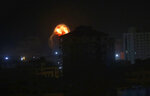 An explosion caused by Israeli airstrikes is seen on Gaza City, early Friday, Friday, March 15, 2019. Israeli warplanes attacked militant targets in the southern Gaza Strip early Friday in response to a rare rocket attack on the Israeli city of Tel Aviv, as the sides appeared to be hurtling toward a new round of violence. (AP Photo/Adel Hana)
