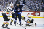 Winnipeg Jets' Paul Stastny (25) celebrates Mark Scheifele's goal on Vegas Golden Knights goaltender Marc-Andre Fleury (29) as Nate Schmidt (88) reacts during the second period of Game 1 of the NHL hockey playoffs Western Conference final, Saturday, May 12, 2108, in Winnipeg, Manitoba. (John Woods/The Canadian Press via AP)