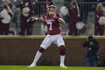 Oklahoma quarterback Spencer Rattler looks for a receiver during the first half of the team's NCAA college football game against Oklahoma State in Norman, Okla., Saturday, Nov. 21, 2020. (AP Photo/Sue Ogrocki)