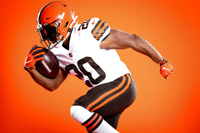 This photo provided by the Cleveland Browns shows the NFL football teams' new uniforms. With a salute to their storied past, the Browns unveiled new uniforms Wednesday, April 15, 2020, to replace old ones that had grown stale and become symbolic with losing. (Matt Starkey/Cleveland Browns via AP)