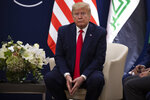 U.S. President Donald Trump meets with Kurdistan Regional Government President Nechirvan Barzani at the World Economic Forum, Wednesday, Jan. 22, 2020, in Davos, Switzerland. The 50th annual meeting of the forum is taking place in Davos from Jan. 21 until Jan. 24, 2020. (AP Photo/Evan Vucci)