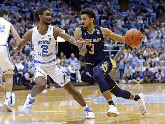 North Carolina's Coby White (2) guards Notre Dame's Prentiss Hubb (3) during the second half of an NCAA college basketball game in Chapel Hill, N.C., Tuesday, Jan. 15, 2019. North Carolina won 75-69. (AP Photo/Gerry Broome)