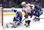 Tampa Bay Lightning goaltender Andrei Vasilevskiy (88) makes a save on a shot by Washington Capitals left wing Alex Ovechkin (8) during the first period of Game 2 of the NHL Eastern Conference finals hockey playoff series Sunday, May 13, 2018, in Tampa, Fla. (AP Photo/Chris O'Meara)