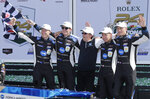 From left to right, Konica Minolta Cadillac DPi-V.R drivers and team owner Ryan Briscoe, Scott Dixon, Wayne Taylor, Kamui Kobayashi and Renger van der Zande celebrate in Victory Lane after winning the Rolex 24-hour auto race at Daytona International Speedway, Sunday, Jan. 26, 2020, in Daytona Beach, Fla. (AP Photo/Terry Renna)