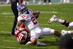 Mississippi quarterback Matt Corral (2) gets taken down by Indiana defensive lineman Jerome Johnson (98) during the first half of the Outback Bowl NCAA college football game Saturday, Jan. 2, 2021, in Tampa, Fla. (AP Photo/Chris O'Meara)